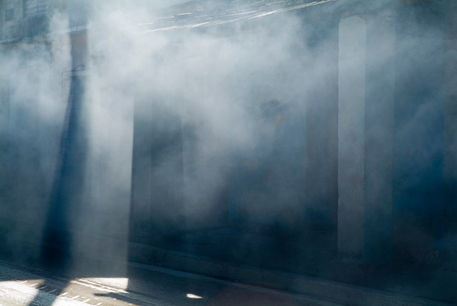 http://www.artflakes.com/en/products/smoke-and-sunlight-mingle-on-a-street-in-trinidad